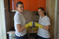Two home cleaners showing thumbs up