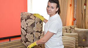End of tenancy cleaner taking care of the upholstery
