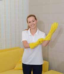 A One-off cleaning professional preparing for work