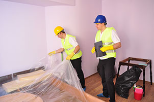 Two Post construction cleaning experts in London cleaning a bedroom