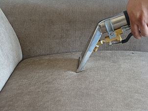 Professional upholstery cleaning London - steam cleaning a sofa