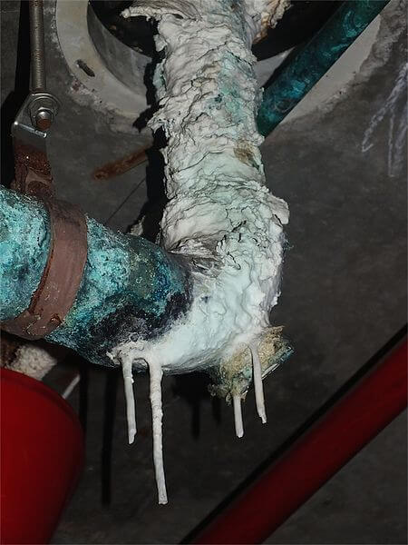 Massive limescale buildup on a water pipe